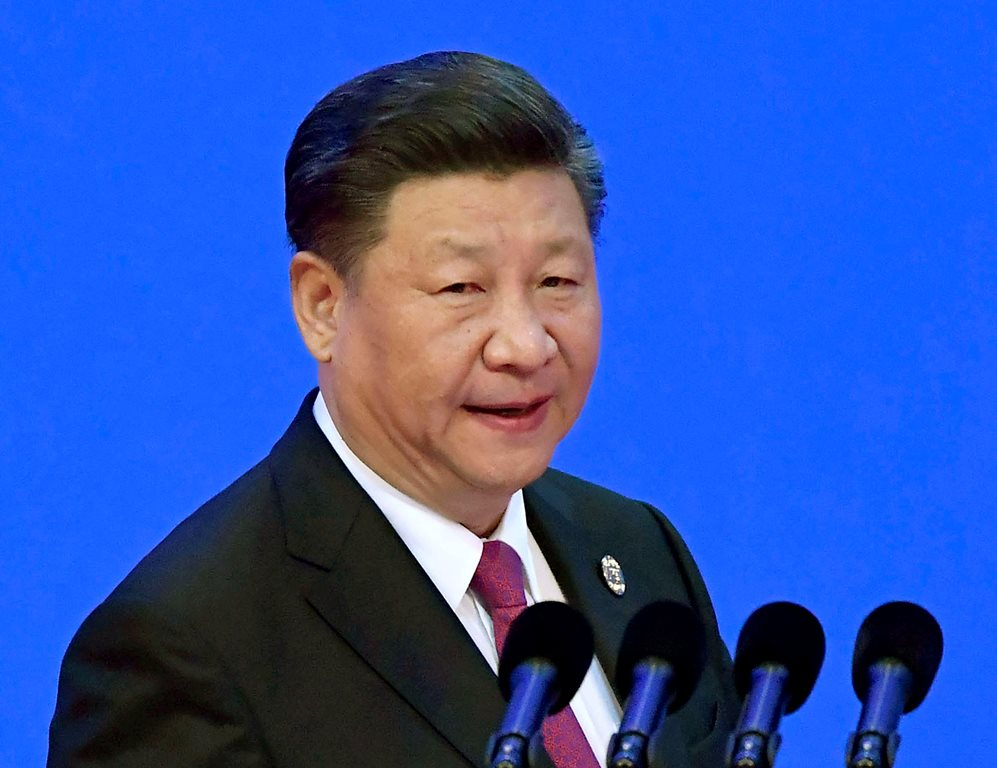 China's President Xi Jinping prepares to deliver his opening speech at the Boao Forum for Asia Annual Conference in Boao in south China's Hainan province, Tuesday, April 10, 2018. Xi promised to cut auto import taxes, open China's markets further and improve conditions for foreign companies in a speech Tuesday that called for international cooperation against a backdrop of a spiraling dispute with Washington over trade and technology.AP/PTI Photo(AP4_10_2018_000032B)