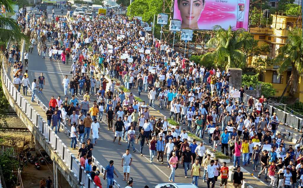 Guwahati: Youths during a protest rally against unidentified people responsible for lynching two men in Central Assam's Karbi Anglong district on suspicion of being 'child lifters', in Guwahati on Sunday, June 10, 2018. (PTI Photo) (PTI6_10_2018_000170B)