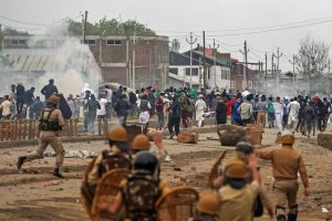 Srinagar: Police and CRPF personnel chase away protesters hurling stones on them during clashes on the outskirts of Srinagar, June 22, 2018. Four militants, a police official and a civilian were killed during gun-battle triggering protests and clashes in which several people were injured. (PTI Photo/ S. Irfan)(PTI6_22_2018_000201B)