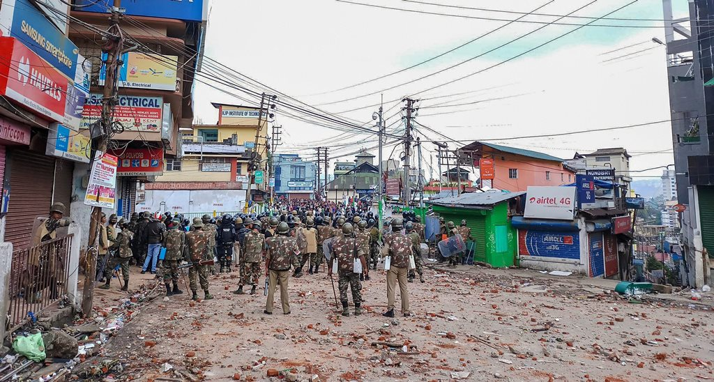 Shillong: Securitymen stand guard a street during curfew in Shillong on Saturday, Jun02,2018. (PTI Photo) (PTI6_2_2018_000159B)