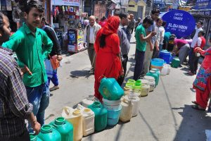 Shimla: People stand in a queue to collect water from a tanker, as the city faces acute shortage of drinking water, in Shimla on Tuesday, May 29, 2018. (PTI Photo) (PTI5_29_2018_000133B)
