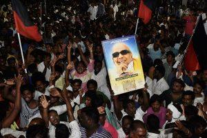 Chennai: Dravida Munnetra Kazhagam (DMK) supporters gather outside the hospital where DMK chief M Karunanidhi is being treated, in Chennai, on Sunday, July 29, 2018. (PTI Photo/R Senthil Kumar) (PTI7_30_2018_000068B)