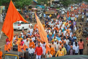 Karad: Protestors from the Maratha community take part in a rally demanding reservation, in Karad, Maharashtra on Tuesday. Maratha outfits have called for a bandh in Maharashtra today, a day after a man demanding reservation for the community jumped to his death in a river in Aurangabad district. (PTI Photo)(PTI7_24_2018_000094B)