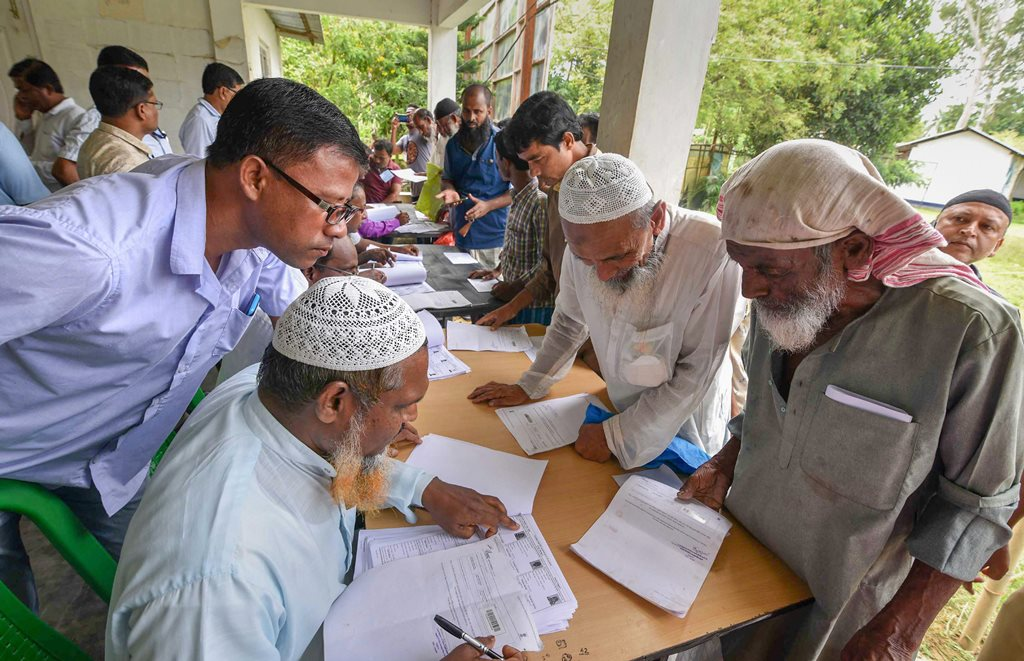 Nagaon: People check their names on the final draft of the state's National Register of Citizens after it was released, at a NRC Seva Kendra in Nagaon on Monday, July 30, 2018. (PTI Photo) (PTI7_30_2018_000108B)