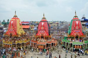 Puri: Devotees pull the chariots during the 141st Rath Yatra, in Puri on Saturday, July 14, 2018. The yatra is taken out every year on Ashadhi Bij, the second day of Ashad month, as per the Hindu calender. Besides the three chariots of Lord Jagannath, his brother Balram and sister Subhadra, the yatra procession comprises of 18 decorated elephants, 101 trucks with tableaux, members of 30 religious groups and 18 singing troupes. (PTI Photo)(PTI7_14_2018_000073B)
