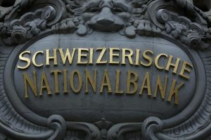 The logo of the Swiss National Bank (SNB) is seen at the entrance of the SNB in Bern December 18, 2014.  REUTERS/Ruben Sprich