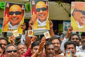 Chennai: DMK supporters gather near the Kauvery Hospital where DMK President M Karunanidhi in undergoing treatment, in Chennai on Tuesday, Aug 7, 2018. Supporters have started thronging the hospital after Karunanidhi's conditions, reportedly, deteriorated on Monday. (PTI Photo) (PTI8_7_2018_000151B)