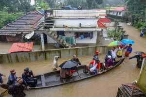 Kochi: Rescue officials assist villagers out of a flooded area following heavy monsoon rainfall, near Kochi on Wednesday, Aug 15, 2018. (PTI Photo) (PTI8_15_2018_000266B)
