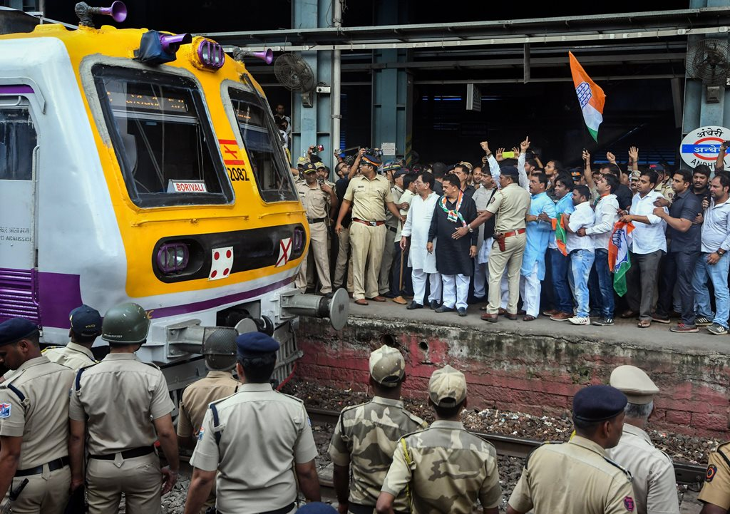 Mumbai: Congress workers stop a train at Andheri during 'Bharat Bandh' protest called by Congress and other Left Front parties against fuel price hike and depreciation of the rupee, in Chikmagalur, Monday, Sept 10, 2018. (PTI Photo/Shirish Shete) (PTI9_10_2018_000056B)