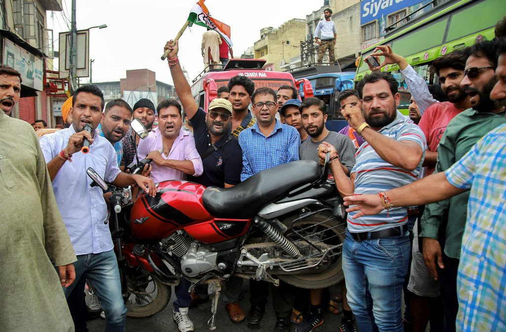 Jammu: Congress Party workers raise slogans during 'Bharat Bandh' protest called by Congress and other parties against fuel price hike and depreciation of the rupee, in Jammu, Monday, Sept 10, 2018. (PTI Photo)(PTI9_10_2018_000065B)