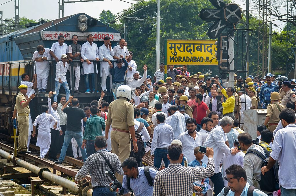 Moradabad: Congress Party supporters stop a train during 'Bharat Bandh' protest called by Congress and other parties against fuel price hike and depreciation of the rupee, in Moradabad, Monday, Sept 10, 2018. (PTI Photo)(PTI9_10_2018_000107B)