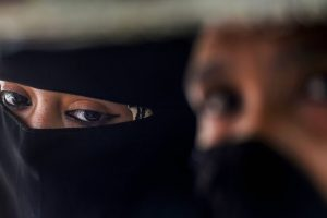 New Delhi: A Muslim woman looks on, near Jama Masjid in New Delhi, Wednesday, Sept 19, 2018. The Union Cabinet approved an ordinance to ban the practice of instant triple talaq. Under the proposed ordinance, giving instant triple talaq will be illegal and void and will attract a jail term of three years for the husband. (PTI Photo/Atul Yadav) (Story No. TAR20) (PTI9_19_2018_000096B)