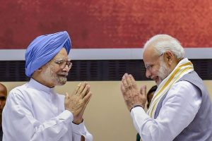 """New Delhi: Prime Minister Narendra Modi and former prime minister Manmohan Singh during a release of the book titled """"Moving On...Moving Forward: A Year in Office"""" published on experiences of M Venkaiah Naidu during his first year as Vice President of India and Chairman of Rajya Sabha, in New Delhi on Sunday, Sept 2, 2018. (PTI Photo/Kamal Singh)(PTI9_2_2018_000057B)"""