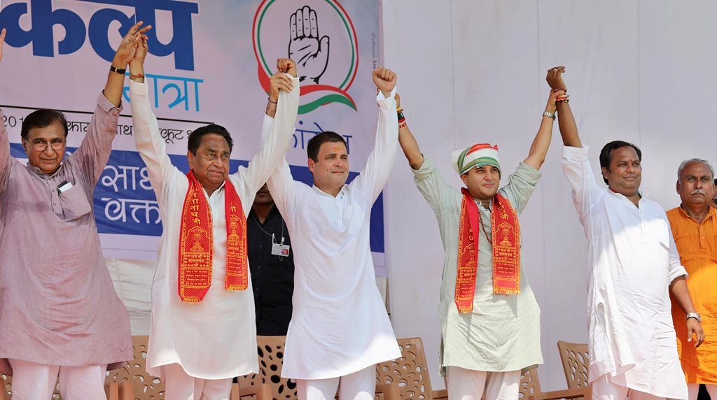Chitrakoot: Congress President Rahul Gandhi with MPCC President Kamal Nath (2nd L), party MP Jyotiraditya Scindia (3rd R) and other leaders during a public meeting in Chitrakoot, Thursday, Sept 27, 2018. (AICC Photo via PTI) (PTI9_27_2018_000139B)