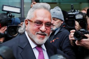 London: F1 Force India team boss Vijay Mallya smiles as he arrives to attend a hearing at Westminster Magistrates Court in London, Wednesday, Sept. 12, 2018. Investigators have accused the 62-year-old of paying $200,000 to a British firm for displaying his company Kingfisher's logo during the Formula One World Championships in London and some European countries in the 1990s. AP/PTI(AP9_12_2018_000201B)