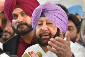Amritsar: Punjab Chief Minister Capt Amrinder Singh with Punjab Minister Navjot Singh Sidhu talk to the media after visiting Guru Nanak Hospital, in Amritsar, Saturday, Oct 20, 2018. A speeding train ran over revellers watching fireworks during the Dussehra festival Friday, killing at least 60 people. (PTI Photo/Kamal Kishore)(PTI10_20_2018_000096B)