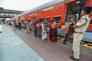 Ahmedabad: Migrant workers wait to board a train out of Gujarat in view of protests and violence breaking out over the alleged rape of a 14-month-old girl, in Ahmedabad, Tuesday, Oct 9, 2018. (PTI Photo/Santosh Hirlekar) (PTI10_9_2018_000084B)