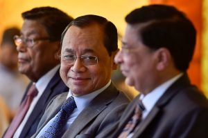New Delhi: Outgoing Chief Justice of India Justice Dipak Misra (R), CJI-designate Justice Ranjan Gogoi and Attorney General of India K. K. Venugopal during the former's farewell function on the Supreme Court lawns in New Delhi, Monday, Oct 1, 2018. (PTI Photo/Ravi Choudhary) (PTI10_1_2018_000181B)