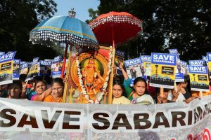 New Delhi: Lord Ayyappa devotees take part in the 'Ayyappa Namajapa Yatra' (chanting the name of Lord Ayyappa) in New Delhi, Sunday, October 14, 2018 against the Supreme Court verdict on the entry of women of all ages into the Sabarimala Lord Ayyappa Temple. (PTI Photo/Shahbaz Khan) (PTI10_14_2018_000087B)