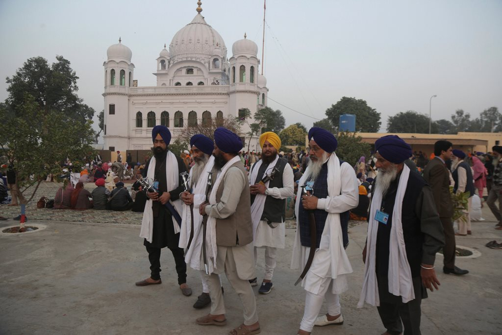 Kartarpur: Visiting Indian Sikh pilgrims visit the shrine of their spiritual leader Guru Nanak Dev in Kartarpur, Pakistan, Wednesday, Nov. 28, 2018. Pakistan's Prime Minister Imran Khan attended the groundbreaking ceremony for the first visa-free border crossing with India, a corridor that will allow Sikh pilgrims to easily visit their shrines on each side of the border. The crossing, known as the Kartarpur corridor is a rare sign of cooperation between the two nuclear-armed rival countries. AP/PTI(AP11_28_2018_000186B)