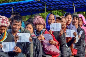 Kanhmun: Voters show their identity card as they stand in a queue at a polling station during the state Assembly elections, at Kanhmun, Mizoram, Wednesday, Nov.28, 2018. (PTI Photo) (PTI11_28_2018_000031)