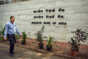 Mumbai: A man walks past near the Reserve Bank of India Headquarters, in Mumbai, Monday, Nov. 19, 2018. RBI board meeting is being held today in Mumbai amid reports of rising tensions between the central bank and the government. (PTI Photo/Shashank Parade) (PTI11_19_2018_000076B)