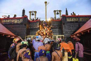 Sabarimala: Devotees enter the Sabarimala temple as it opens amid tight security, in Sabarimala, Friday, Nov. 16, 2018. (PTI Photo) (Story no. MDS18) (PTI11_16_2018_000138B)