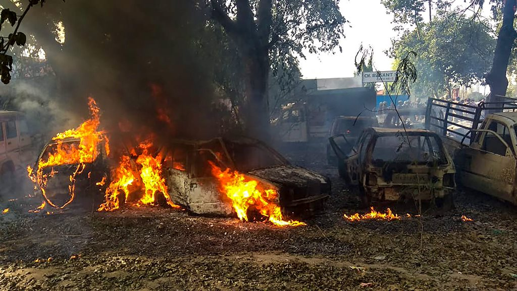 Bulandshahr: Vehicles set on fire by a mob during a protest over the alleged illegal slaughter of cattle, in Bulandshahr, Monday, Dec. 03, 2018. According to Additional Director General of Meerut zone Prashant Kumar, protesters from Mahaw village and nearby areas pelted stones on the police and indulged in arson setting several vehicles and the Chingarwathi Police Chowki on fire. (PTI Photo) (PTI12_3_2018_000175B)