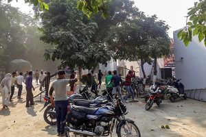 Bulandshahr: A mob pelts brickbats during a protest over the alleged illegal slaughter of cattle, in Bulandshahr, Monday, Dec. 03, 2018.  According to Additional Director General of Meerut zone Prashant Kumar, protesters from Mahaw village and nearby areas pelted stones on the police and indulged in arson setting several vehicles and the Chingarwathi Police Chowki on fire. (PTI Photo) (PTI12_3_2018_000174B)
