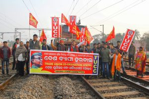 """Bhubaneswar: Central trade union activists block a train during their 48-hour-long nationwide general strike in protest against the """"anti-people"""" policies of the Centre, in Bhubaneswar, Tuesday, Jan 8, 2019. (PTI Photo)  (PTI1_8_2019_000051B)"""