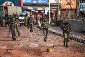 Jammu: Army personnel patrol a street during a curfew, imposed after clashes between two communities over the protest against the Pulwama terror attack, in Jammu, Saturday, Feb. 16, 2019. (PTI Photo)(PTI2_16_2019_000057B)
