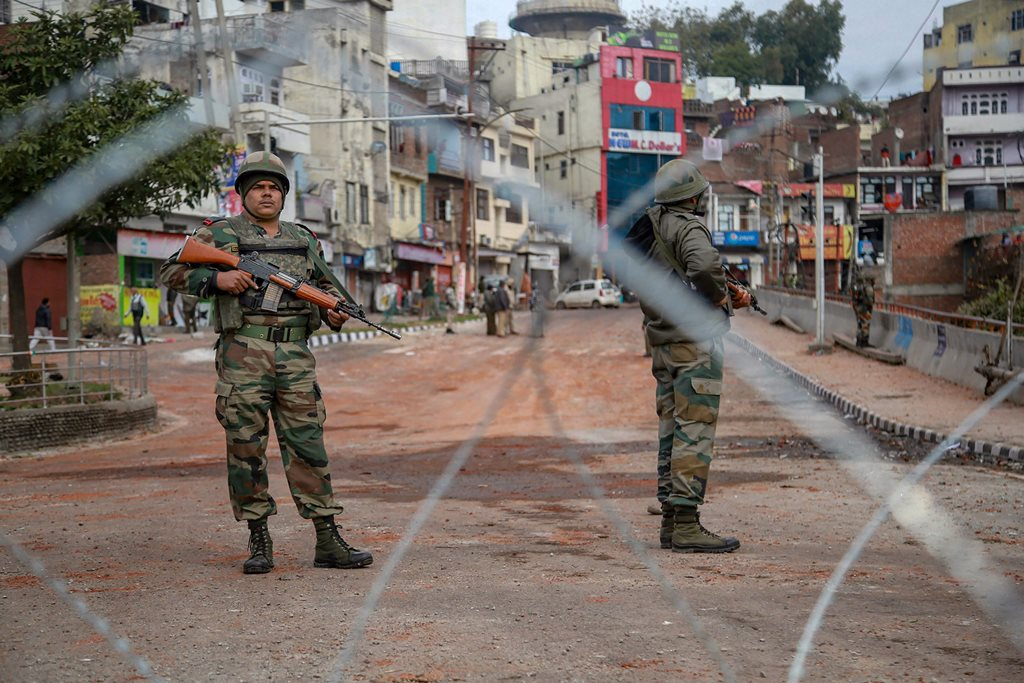 Jammu: Army personnel stand guard at Gujjar Nagar area during a curfew, imposed on the third day after the clash between two communities over the protest against the Pulwama terror attack, in Jammu, Sunday, Feb. 17, 2019. (PTI Photo)(PTI2_17_2019_000035B)
