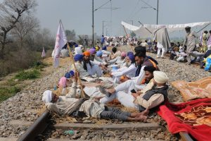 Amritsar: Farmers block a railway tracks during a protest organized under the banner of Kisan Mazdoor Sangharsh Committee (KMSC) against the alleged anti-farmer policies of the state government, at village Devi Dass Pura, 20 km from Amritsar, Tuesday, March 5, 2019. (PTI Photo) (PTI3_5_2019_000090B)