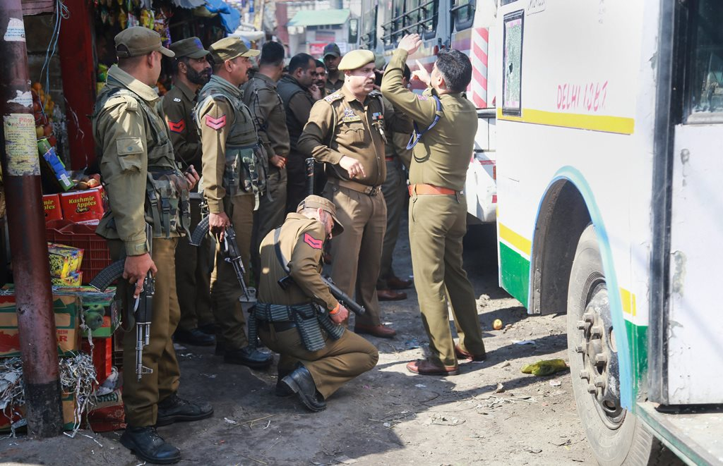 Jammu: Police personnel inspect the site after a powerful explosion at a bus stand, in Jammu, Thursday, March 07, 2019. (PTI Photo)(PTI3_7_2019_000022B)