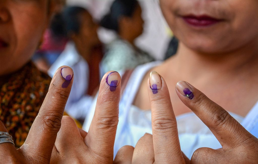 Ri-Bhoi: Women voters show their fingers marked with indelible ink after casting vote during the first phase of the general elections, at Umpher in Ri-Bhoi district, Thursday, April 11, 2019. (PTI Photo)(PTI4_11_2019_000041B)