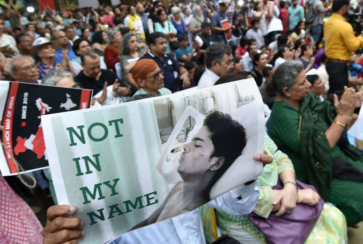 """New Delhi : Citizens hold placards during a silent protest """" Not in My Name """" against the targeted lynching, at Jantar Mantar in New Delhi on Wednesday. PTI Photo by Shahbaz Khan(PTI6_28_2017_000201a)"""