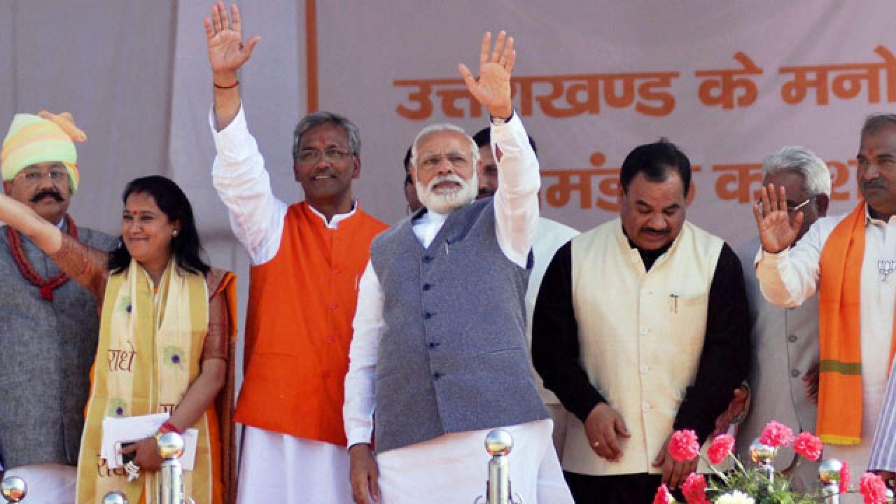 प्रधानमंत्री नरेंद्र मोदी के साथ उत्तराखंड के मुख्यमंत्री त्रिवेंद्र सिंह रावत.(फाइल फोटो: पीटीआई)