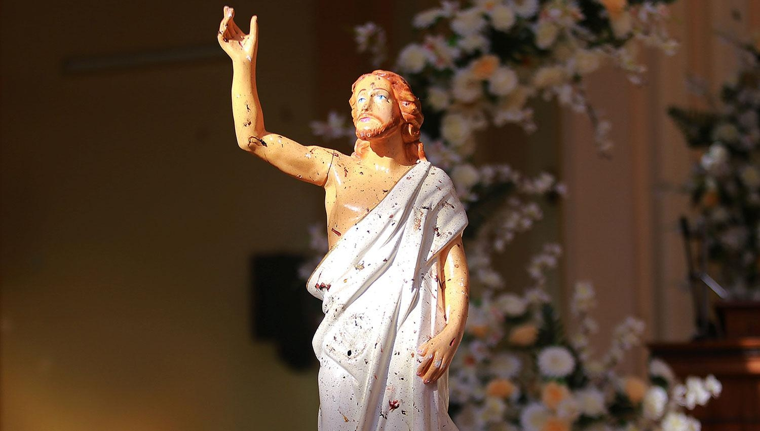 Blood stains are seen on a statue of Jesus Christ after a bomb blast inside a church in Negombo, Sri Lanka. (Photo: Reuters)