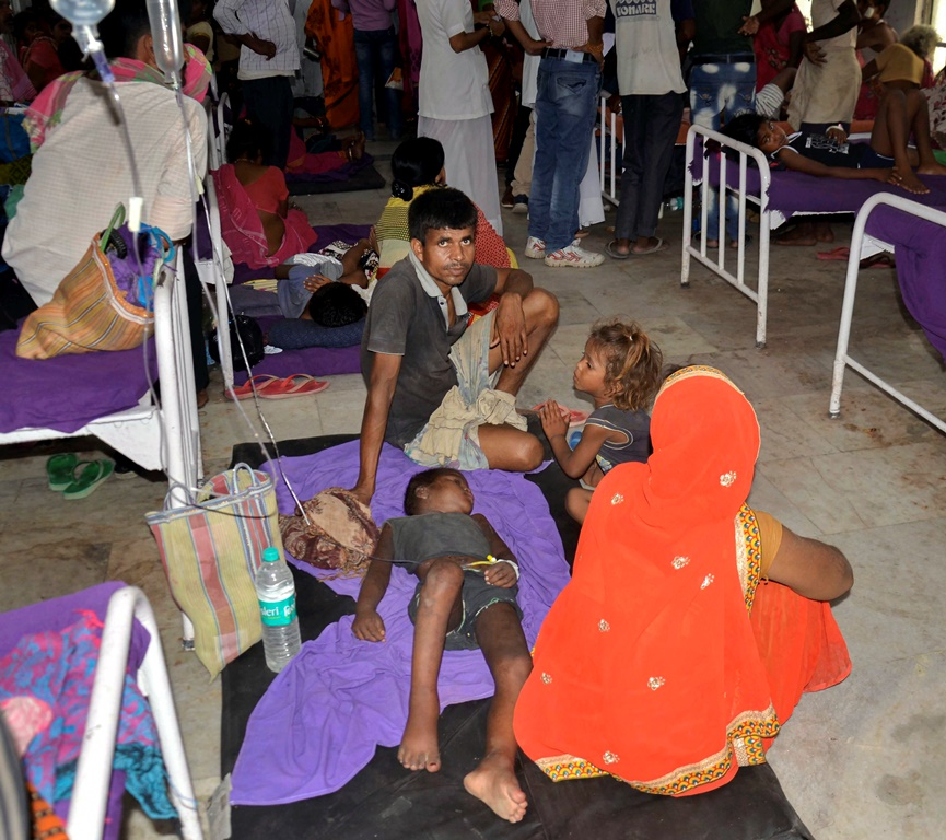 Muzaffarpur: A view of an over-crowded ward with children showing symptoms of Acute Encephalitis Syndrome (AES) as they undergo treatment at a hospital, in Muzaffarpur, Monday, June 17, 2019. The death toll rose to 100 in Muzaffarpur and the adjoining districts in Bihar. (PTI Photo) (PTI6_17_2019_000139B)
