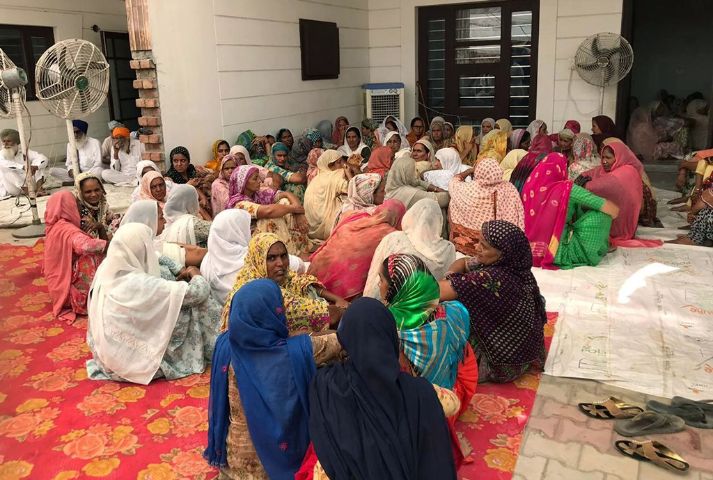 Sangrur: People gather at the residence of Fatehvir Singh, a two-year-old child who died after falling in a 150-foot-deep unused borewell, for the last rites in Sangrur district, Tuesday, June 11, 2019. (PTI Photo) (PTI6_11_2019_000079B)