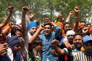 Sangrur: People stage a protest against the district administration and the state government over delay in the rescue of Fatehvir Singh, a two-year-old child who died after falling in a 150-foot-deep unused borewell, in Sangrur district, Tuesday, June 11, 2019. (PTI Photo) (PTI6_11_2019_000080B)