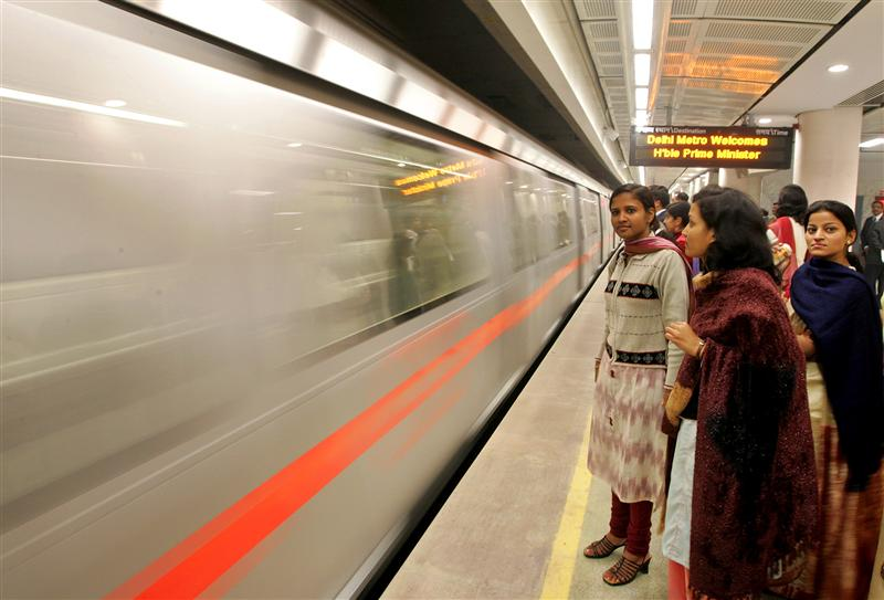 Guest wait to board the first underground metro train after its inauguration by Prime Minister Manmohan Singh, in New Delhi, December 19, 2004. The technology used to run the metro system is so advanced there is no possibility of a train wreck, the chief of the project has claimed. New Delhi aims to have 62 kilometres of track running by December 2005 with a capacity of two million passengers a day. REUTERS/Kamal Kishore  KK/LA