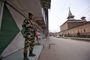A Central Reserve Police Force (CRPF) personnel stands guard in front of closed shops next to the Jamai Masjid in Srinagar February 23, 2019. REUTERS/Danish Ismail