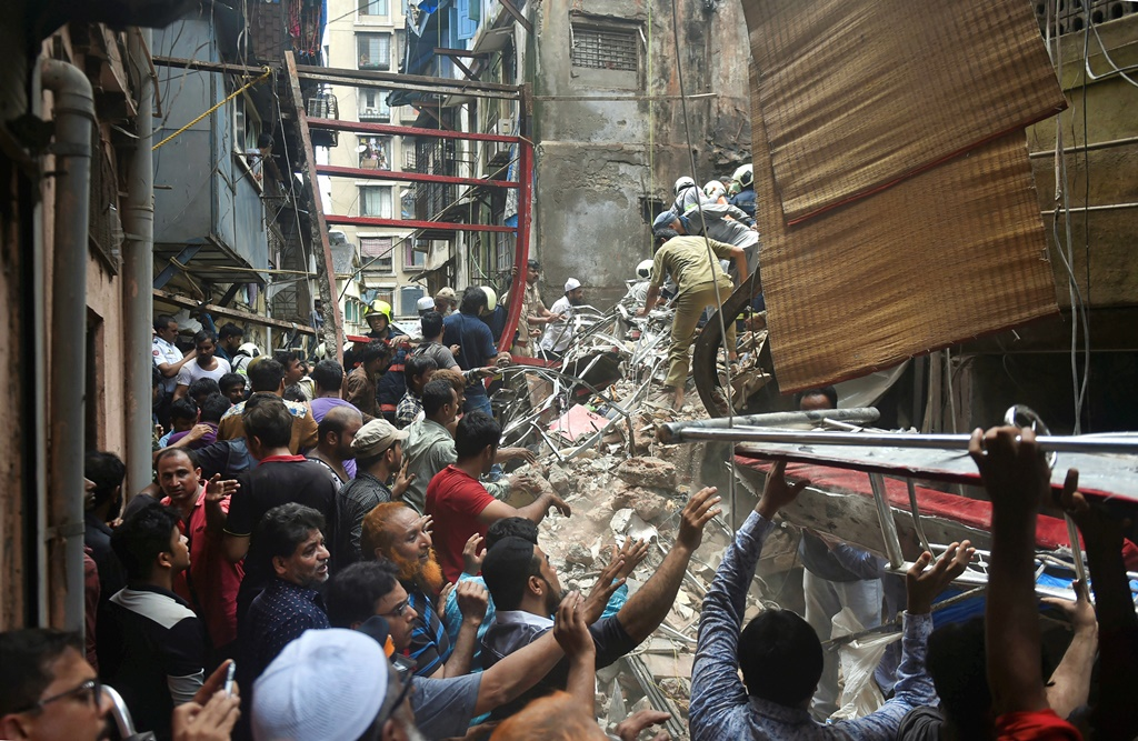 Mumbai: Rescue and relief works underway after the collapse of the four-storey Kesarbai building at Dongri in Mumbai, Tuesday, July 16, 2019. Around 40 to 50 occupants of the building are feared trapped under the debris as per a BMC official. (PTI Photo/Mitesh Bhuvad) (PTI7_16_2019_000056B)