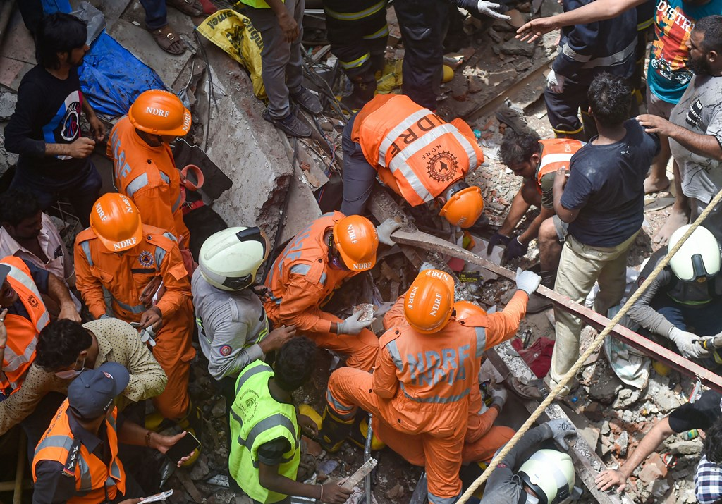 Mumbai: Fire Brigade and NDRF personnel carry out rescue works after the collapse of the four-storey Kesarbai building at Dongri in Mumbai, Tuesday, July 16, 2019. Around 40 to 50 occupants of the building are feared trapped under the debris as per a BMC official. (PTI Photo/Mitesh Bhuvad) (PTI7_16_2019_000058B)