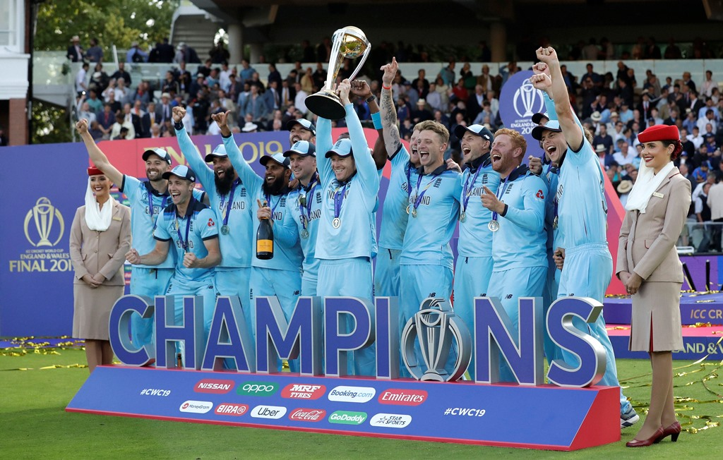 London: England's captain Eoin Morgan is sprayed with champagne as he raises the trophy after winning the Cricket World Cup final match between England and New Zealand at Lord's cricket ground in London, Sunday, July 14, 2019. England won after a super over after the scores ended tied after 50 overs each. AP/PTI Photo(AP7_15_2019_000016B)