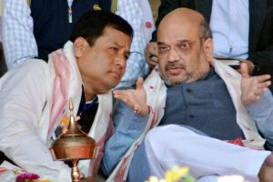 BJP national president Amit Shah with the party's Assam president Sarbananda Sonowal during a party workers conference in Dibrugarh, Assam on Friday. Credit: PTI