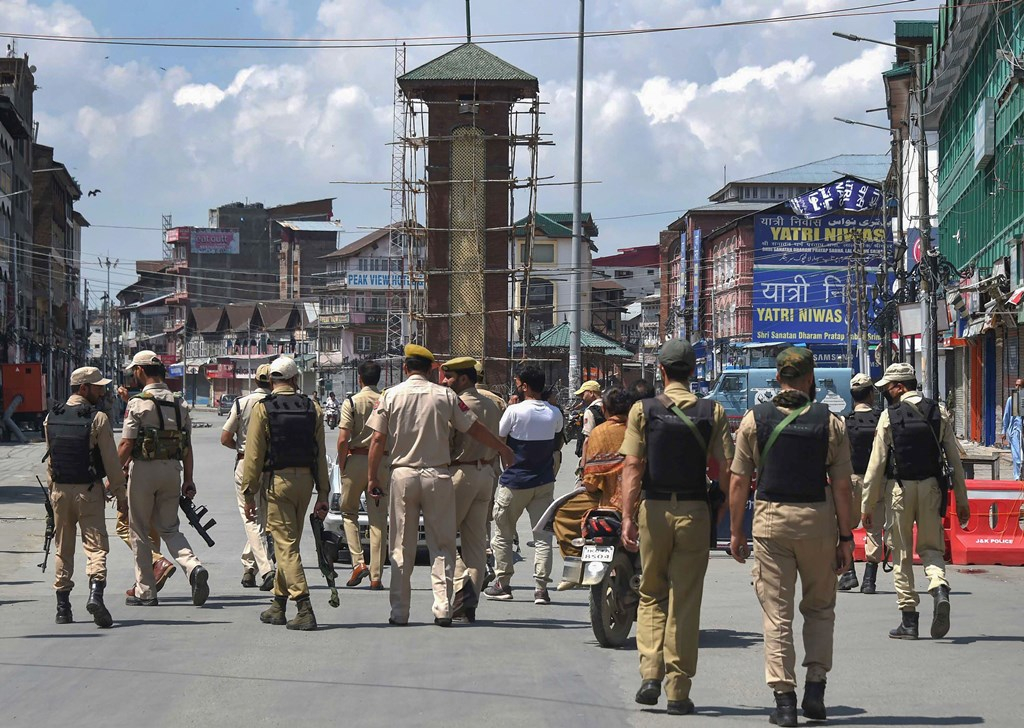 Srinagar: Policemen patrolling at Lal Chowk after restrictions were lifted, in Srinagar, Tuesday, Aug. 20, 2019. Barricades around the Clock Tower in Srinagar's city centre Lal Chowk were removed after 15 days, allowing the movement of people and traffic in the commercial hub, as restrictions eased in several localities while continuing in others. (PTI Photo/S. Irfan)(PTI8_20_2019_000114B)