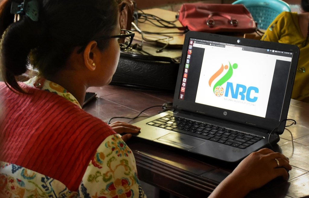 Guwahati: An official checks the documents submitted by people at an National Register of Citizens (NRC) Seva Kendra in Guwahati, Friday, Aug 30, 2019. The NRC with the final list of citizens will be published tomorrow on August 31, 2019. Chief Minister of Assam Sarbananda Sonowal has asked people not to panic, and has directed all Government agencies of Assam to cooperate with people. (PTI Photo)(PTI8_30_2019_000055B)
