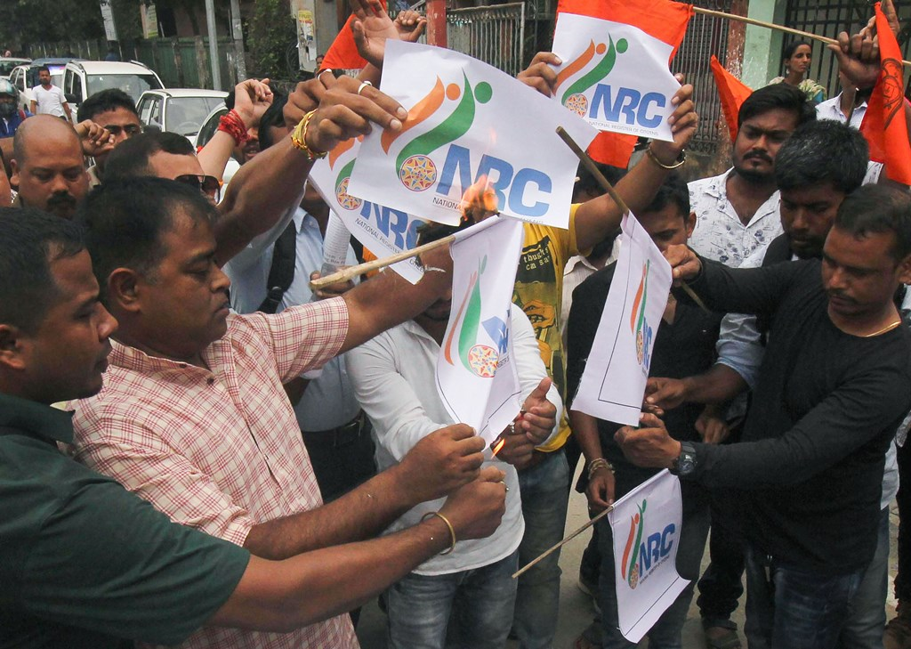 Guwahati: Hindu Yuba Chatra Parisad members protest against the release of NRC final draft, in Guwahati, Saturday, Aug 31, 2019. More than 19 lakh people have been left out and over 3.11 crore included in the final NRC list in Assam. (PTI Photo) (PTI8_31_2019_000062B)